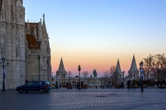 Buda temple church of Matthias. Buda`s Castle District. Pink and orange sky at sunset. Hungary, Budapest, Royalty Free Stock Photography