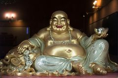 Budai / Hotei, smiling fat and obese buddhist monk stock image