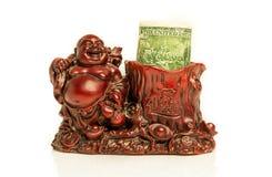 Budai och dollar Arkivbilder
