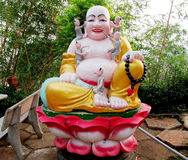 Budai sitting in lotos colorful statue royalty free stock image