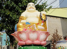 Budai sitting in lotos colorful statue Stock Image