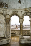 Budapest. View over the rooftops of Budapest, Danube and Parliament building framed by an arch in Fisherman's Bastion on Castle Hill Stock Photography