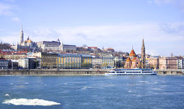 Budapest. View on danube river and ferry boat, melted ice snow Royalty Free Stock Photography