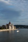 Budapest bankside scene. Budapest parliament on the Danube bankside and tourist boat Royalty Free Stock Image