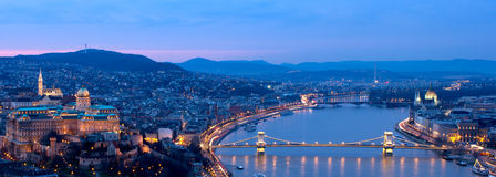 Budapest blue hour panorama. Blue hour panorama of the parlaiment, the Citadel and the Chain bridge in Budapest, Hungary Stock Photo