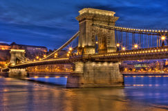 Budapest Bridge. Széchenyi Chain Bridge  at dusk in Budapest Hungary taken with a 30 second shutter speed at a tiny aperture Stock Photography