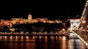Budapest castle and chain bridge at night stock photo