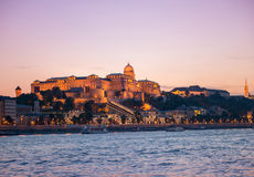 Budapest Castle at sunset, view from Danube. Illuminated Budapest Castle at sunset with colorful sky on the background, beautiful view from Danube Stock Images