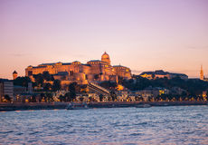 Budapest Castle at sunset, view from Danube. Illuminated Budapest Castle at sunset with colorful sky on the background, beautiful view from Danube Stock Image