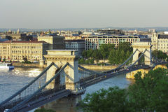 Budapest chain bridge. Lit with sunsetting colors Stock Photos