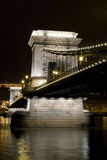 Budapest chain bridge danube night long exposure. Budapest chain bridge danube by night long exposure river flowing with architectural lighting bulb Stock Photography