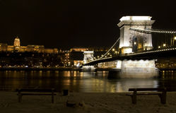 Budapest chain bridge in winter by night danube. Budapest bridge chain by night long exposure of danube long exposure both shores with architectural lights Stock Photography