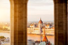 Budapest city with Parliament building. Cityscape view trhough the arch on the famous Parliament building during the sunset light in Budapest, Hungary Stock Photos