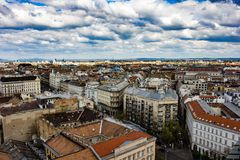 Budapest city seen from above. From St.Stephen`s basilica on a sunny and cloudy day Stock Photos