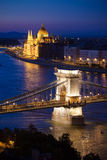 Budapest cityscape sunset with Chain Bridge in front over Danube. River and with Parliament Building in the background Royalty Free Stock Photo