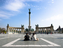 Budapest, Couple Sitting In Middle Of Heroes Square Stock Photos