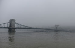 Budapest Danube bridge in a fog. At a winter time Stock Photos