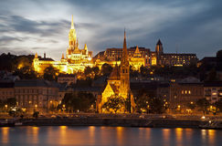 Budapest in dask. Budapest - St. Matthew's Cathedral and Calvin's church in dusk Royalty Free Stock Photos