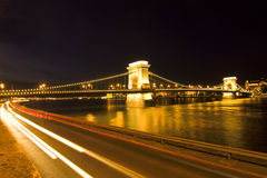 Budapest evening. Budapest chain bridge with car lights in front Royalty Free Stock Image
