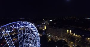 Budapest eye – the  Giant Ferris Wheel in the moon light. (Aerial) stock video footage