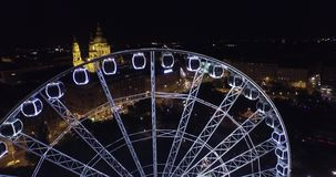 Budapest eye – the  Giant Ferris Wheel in the moon light. (Aerial) stock video