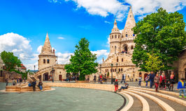 Budapest Fishermans Bastion square famous touristic landmark. On background blue sky white clouds green trees royalty free stock image