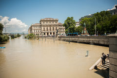 Budapest floods. People watching the show of the swollen Danube on its banks in Budapest Stock Photo