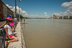 Budapest floods. People watching the show of the swollen Danube on its banks in Budapest Stock Image
