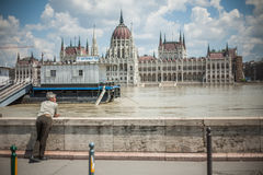 Budapest floods. People watching the show of the swollen Danube on its banks in Budapest Stock Images