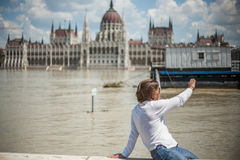 Budapest floods. People watching the show of the swollen Danube on its banks in Budapest Royalty Free Stock Photo