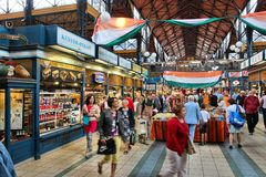 Budapest Great Market Hall. BUDAPEST, HUNGARY - JUNE 19, 2014: People visit Great Market Hall in Budapest. Opened in 1897, it remains the largest and oldest royalty free stock image