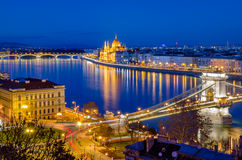 Budapest, Hungarian Parliament and Danube at blue hour. Budapest, Hungarian Parliament, Chain Bridge and Danube at blue hour Royalty Free Stock Photos