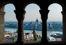 Budapest and hungarian parliament view through the arch of fisherman`s bastion - Hungary. Panorama of Budapest and hungarian parliament gothic building through royalty free stock photos