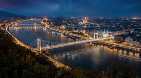Budapest, Hungary - Aerial panoramic skyline of Budapest at blue hour. This view includes Elisabeth Bridge. Erzsebet Hid, Szechenyi Chain Bridge, Parliament and royalty free stock photos