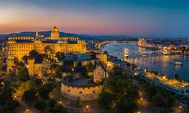 Budapest Hungary - Aerial panoramic skyline view of Budapest at blue hour with Buda Castle Royal Palace. Szechenyi Chain Bridge, Parliament and sightseeing stock photo