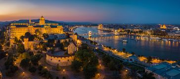 Budapest Hungary - Aerial panoramic skyline view of Budapest at blue hour with Buda Castle Royal Palace, Szechenyi Chain Bridge, P. Arliament, St.Stephen`s stock images