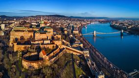 Budapest, Hungary - Aerial panoramic skyline view of Buda Castle Royal Palace with Szechenyi Chain Bridge, Hungarian Parliament. And Matthias Church at sunrise royalty free stock image