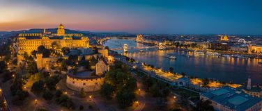 Budapest Hungary - Aerial panoramic skyline view of Budapest at blue hour with Buda Castle Royal Palace. Szechenyi Chain Bridge, Parliament, St.Stephen`s royalty free stock photos