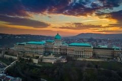 Budapest, Hungary - Aerial panoramic view of the famous Buda Castle Royal Palace at sunset with amazing colorful sky. And clouds royalty free stock photography