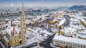 Budapest, Hungary - Aerial panoramic view of the snowy Buda district with Matthias Church, Buda Castle Royal Palace stock photos