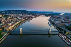 Budapest, Hungary - Aerial skyline view of Budapest above River Danube with famous Szechenyi Chain Bridge. Hungarian Parliament and colorful sky royalty free stock photos