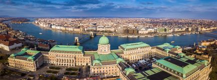 Budapest, Hungary - Aerial skyline view of the famous Buda Castle Royal Palace at Castle District. With Szechenyi Chain Bridge and other landmarks at background stock photos
