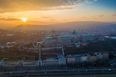 Budapest, Hungary - Aerial sunset view of Buda Castle Royal Palace and Varkert bazar. With Buda Hills at background stock images