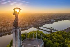 Budapest, Hungary - Aerial view of the beautiful Hungarian Statue of Liberty with Liberty Bridge and skyline of Budapest. At sunrise with clear blue sky Stock Image