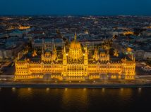 Budapest, Hungary - Aerial view of the beautiful illuminated Parliament of Hungary Orszaghaz at blue hour. With skyline iof Budapest at background Stock Photography