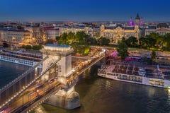 Budapest, Hungary - Aerial view of the beautiful illuminated Szechenyi Chain Bridge with St. Stephen`s Basilica