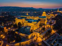 Budapest, Hungary - Aerial view of the famous Buda Castle Royal Palace at blue hour with beautiful colorful sky. And Buda Hills at background stock images