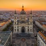 Budapest, Hungary - Aerial view of famous St. Stephen`s Basilica in the morning with golden rising sun. At behind royalty free stock photo