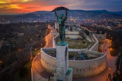 Budapest, Hungary - Aerial view of the Hungarian Statue of Liberty with Buda Hills and amazing colorful sunset. Behind at winter time stock photography