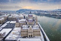 Budapest, Hungary - Aerial view of the Parliament of Hungary on a snowy december morning with Szechenyi Chain Bridge stock image